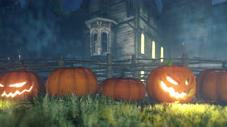 perili : Halloween background animation with the concept of creepy glowing pumpkins and old creepy mansion. Stok Video