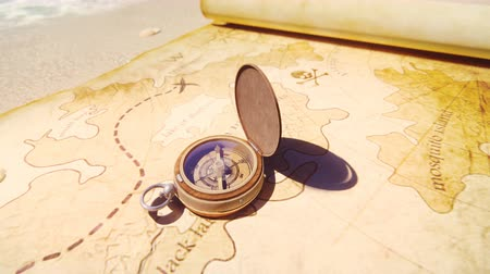 stary : Pirate compass on the Treasure Map lying on the sand on the island of pirates. Vintage beautiful pirate compass lying on an old pirate treasure map.