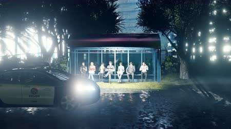 Young people waiting for the bus at the bus stop. Stylish business people are waiting for public transport while sitting at the modern bus stop in the evening.