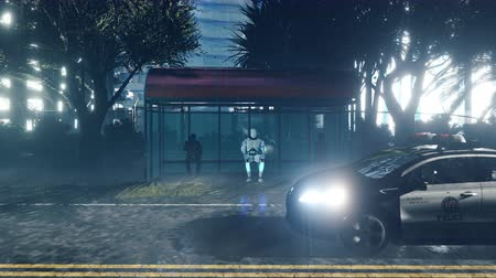 android : A futuristic humanoid robot sits alone at a bus stop. The concept of the future.