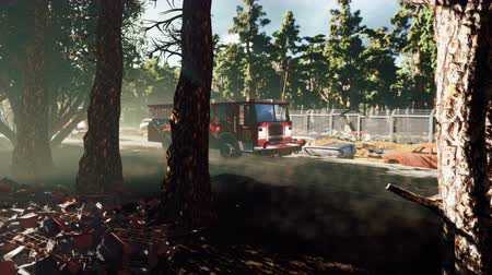 apokalypse : On an abandoned deserted road going fire engines and police car. On the roadside rusty abandoned cars and piles of technological rusty and dusty debris. The Concept of The Apocalypse.
