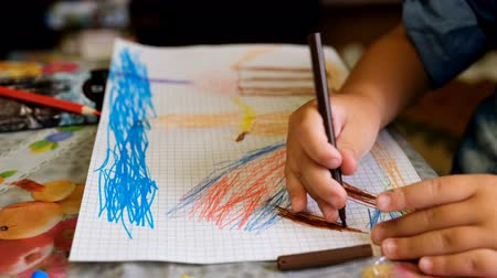 Happy child draws fairy-tale character with felt-tip pens on paper Wideo