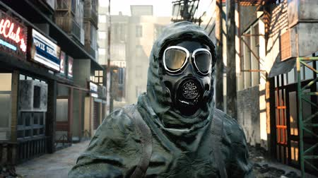mines : A stray man in military protective clothing and a gas mask is walking through the ruined city. The concept of a post-Apocalyptic world after a nuclear war.