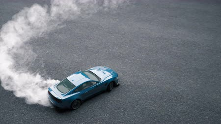 arrasto : Drift sports car on the asphalt. Thick smoke from burning tires.