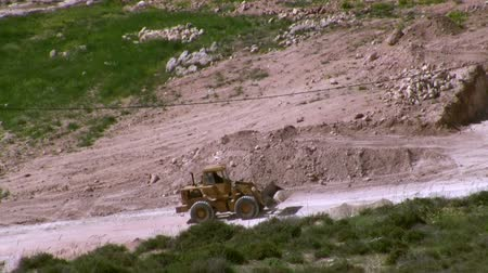 bagger : bulldozer open new road in vally