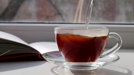 hot pot : Pour boiling water in a cup of coffee on a sunny window Stock Footage