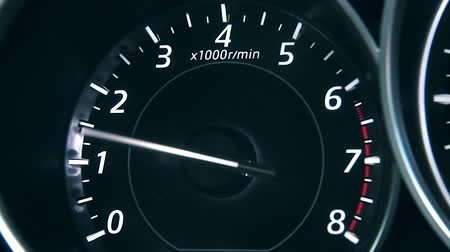 tachometer : Car speedometer and moving,featuring lights leaks, a speedometer, and long exposure time lapse traffic.