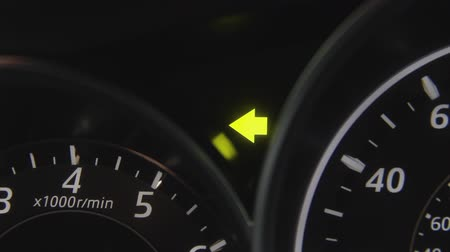 Car turning signal or indicator blinking.