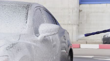 Slow Motion Video of a Car Washing Process on a Self-Service Car Wash