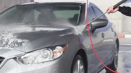 wasmiddel : Slow Motion Video of a Car Washing Process on a Self-Service Car Wash