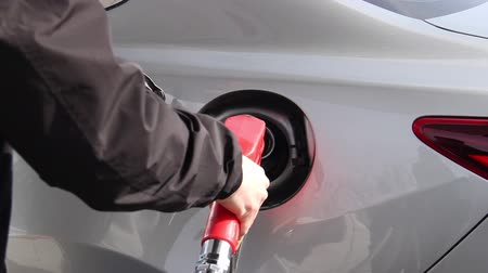 tankowanie : Closeup of man filling benzine gasoline fuel in car at gas station