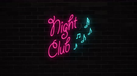 fluorescent : Neon Night club sign with notes on brick wall