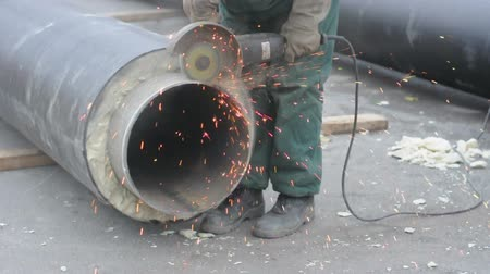 iron pipe : Worker cutting pipe with grinder
