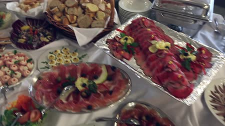буфет : Food served on the table - a.k.a. swedish table: meat, rice, pasta, salads and various cakes and pastries - cheese cake and similar and fruits (apples, bananas, oranges), moving steadicam shot