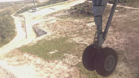 mraky : View from the inside of an airplane landing on airport runway in Dubrovnik, Croatia; with undercarriage visible while touching the runway
