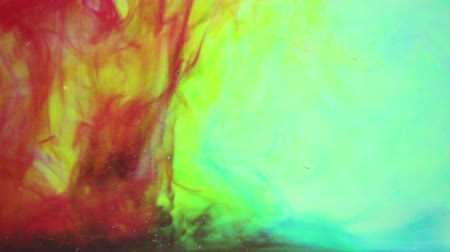 colorful drops : Abstract video ink in water. Background picture with many different colors.