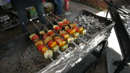 shish kebab : Cooking vegetables on the fire. Tomatoes, peppers and zucchini on the skewer. Vegetarian healthy food