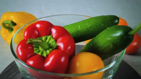 peper : Freshly washed red and yellow pepper and cucumber spinning plate Stock Footage