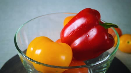 peper : Freshly washed red and yellow pepper spinning plate