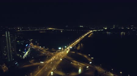 drone : Night flight near the road. View of the city from a height. Shooting of the night road by a quadrocopter.