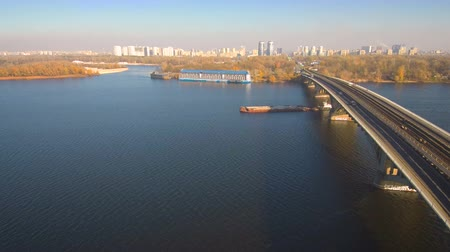 Aerial, top view from Drone: Barge with sand ship sails on the river. Shipping on the river.