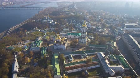 pozlacený : Aerial, top view from Drone: Kiev, Ukraine. Pechersk Lavra Monastery. Flight over the territory of the church complex. Dostupné videozáznamy