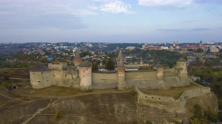 Aerial, top view from Drone. Flying over the old beautiful castle Kamenetz Podolsk. Top view of the castle. Autumn time.