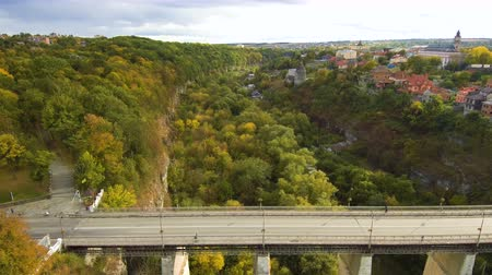 Aerial, top view from Drone. The bridge between the rocks in Kamenetz Podolsky. View of the road from the top. Autumn time.