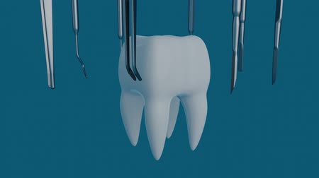 насаждение : Tooth on a blue background with a dentist tool. Dentist tool for inspect of the teeth.