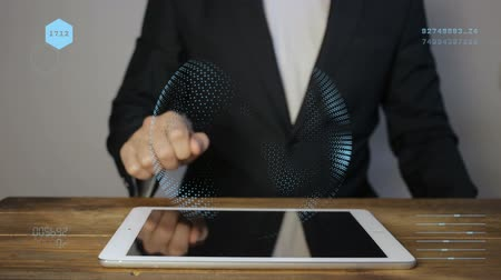 dokunaklı : Businessman working on a holographic interface.The man in the jacket, touching, visual screen, white icons on the tablet. The appearance of charts, and graphics areas. slider