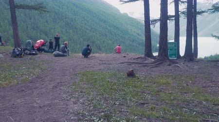 urban exploration : Friends camping on the mountain making a stop to eat and drink in the forest Stock Footage