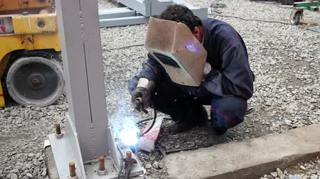 metal worker : Construction worker welding at construction site. HD1080p.