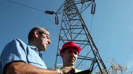 опасность : Electricians Under the High Voltage Tower