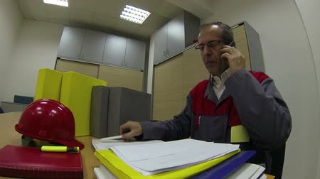 coo : Project manager reading documents in office and talking on cellphone.HD1080p.GoPro HERO3.