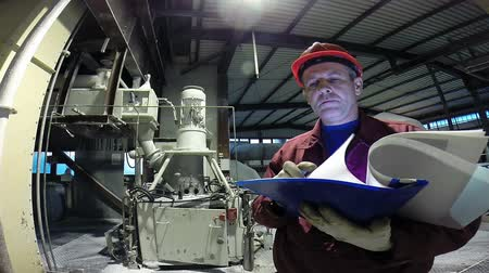 mérnök : Engineer in manufacturing plant checking technical data.HD1080p.
