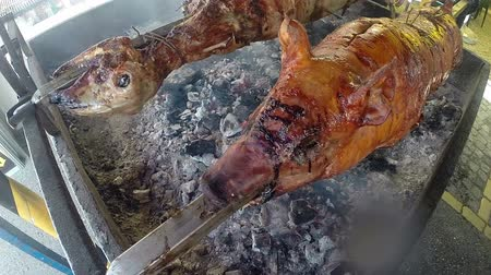 sheep pig : Pig and lamb roasted on a rotating spit over hot charcoal. HD1080p