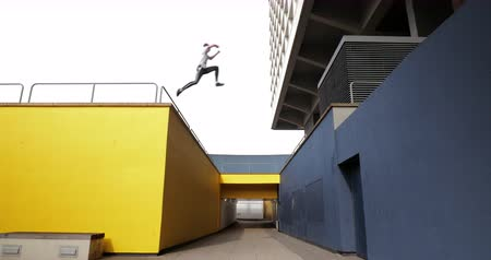 bold : Freerunner is jumping between bold buildings in the city. Stock Footage