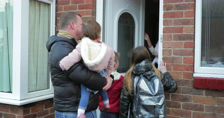 front or back yard : Mature man and his children have arrived home after picking up his eldest daughter from school.