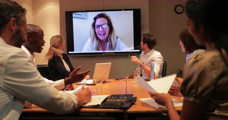 casual wear businessman : Surface level view of a group of business people having a late night meeting and a video call. Stock Footage