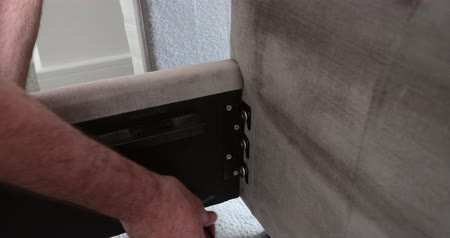 винты : Close up shot of a mature man using an alan key to build part of a bed frame. Стоковые видеозаписи