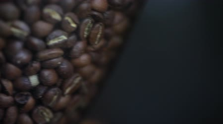 zahmetsiz : A close up, panning, shot of coffee beans.