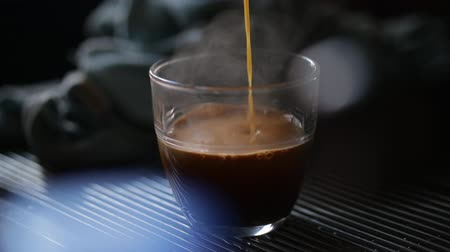 establishment : Pouring an expresso into a customers glass. Stock Footage