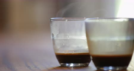núpcias : A still shot of steam flowing from two lattes that are on the table. Stock Footage