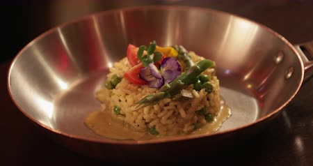green peas : Close-up of a restaurant style risotto dish in a restaurant. Stock Footage