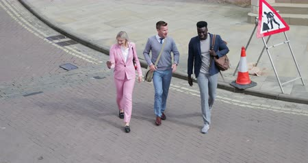 move well : Two businessmen and one businesswoman walking home from work together. Stock Footage