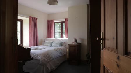 doorway : A backwards panning shot of a bedroom interior from a home in northeastern England. Stock Footage
