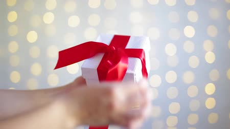 fitas : christmas concept - female hands opening christmas gift box