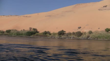 aswan : A Beautiful Sand Dune Adjacent to the Water of the River Nile in Egypt on a Sunny Day Stock Footage
