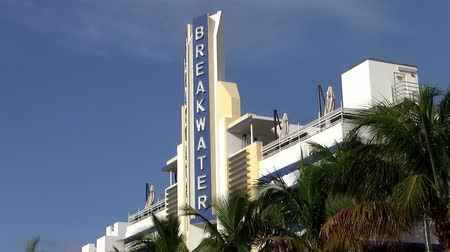 projetado : Miami, Florida, USA - Circa July 2013: Blue and White Facade and Sign of the Famous Art Deco Breakwater Hotel on the Ocean Drive, Miami Beach, Florida designed by Anton Skislewicz in 1939. Vídeos