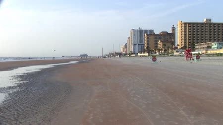 Automobile Friendly Beach in Daytona Beach with Road Signs and Speed Limit and Hotel Buildings in the Background